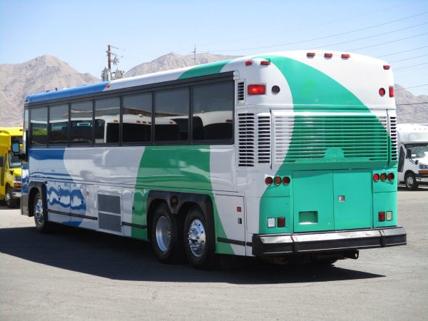 Rear Drivers Side View of 2004 MCI D4000 ADA Highway Coach