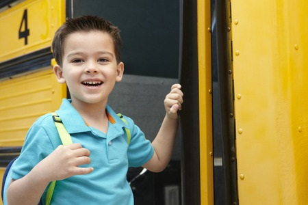 Child Happy Getting on School Bus